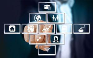 Ein Finger der auf verschiedene Buttons drückt, als symbolisierung für digitale Dienste
